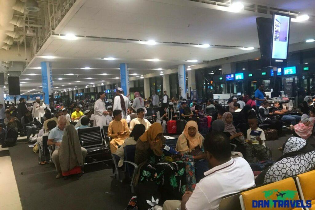 Passengers waiting for their flights at Dubai International Airport - Russia itinerary