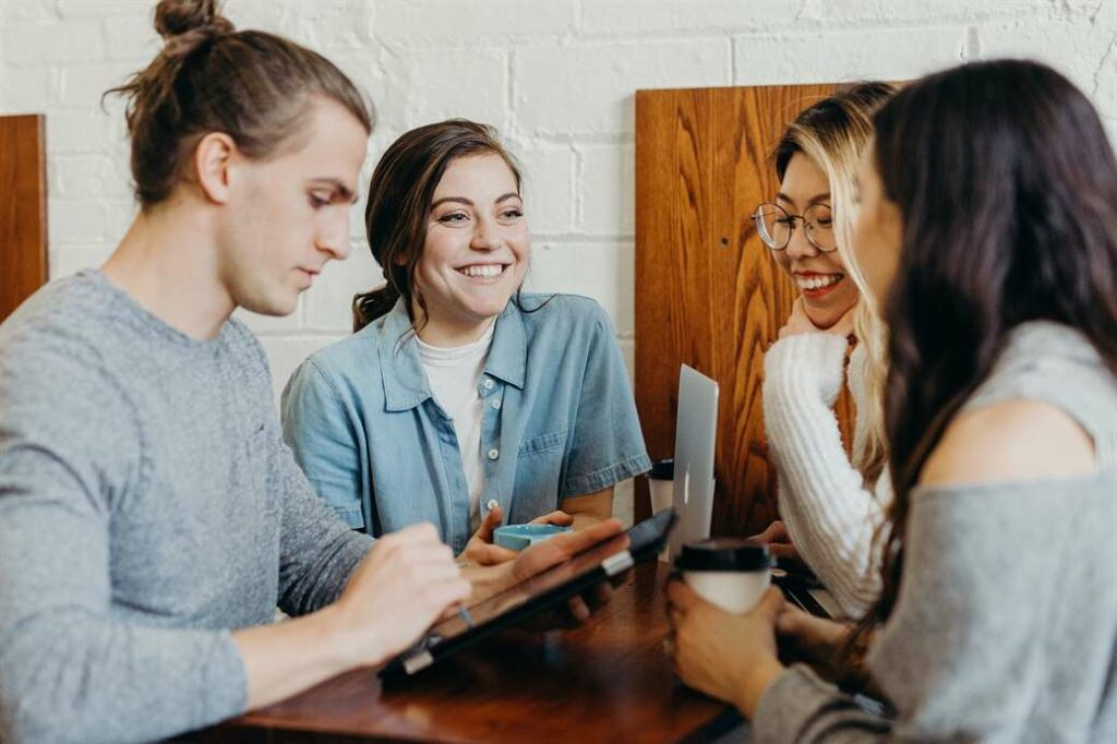 Friends meeting for language exchange sites or penpal sites