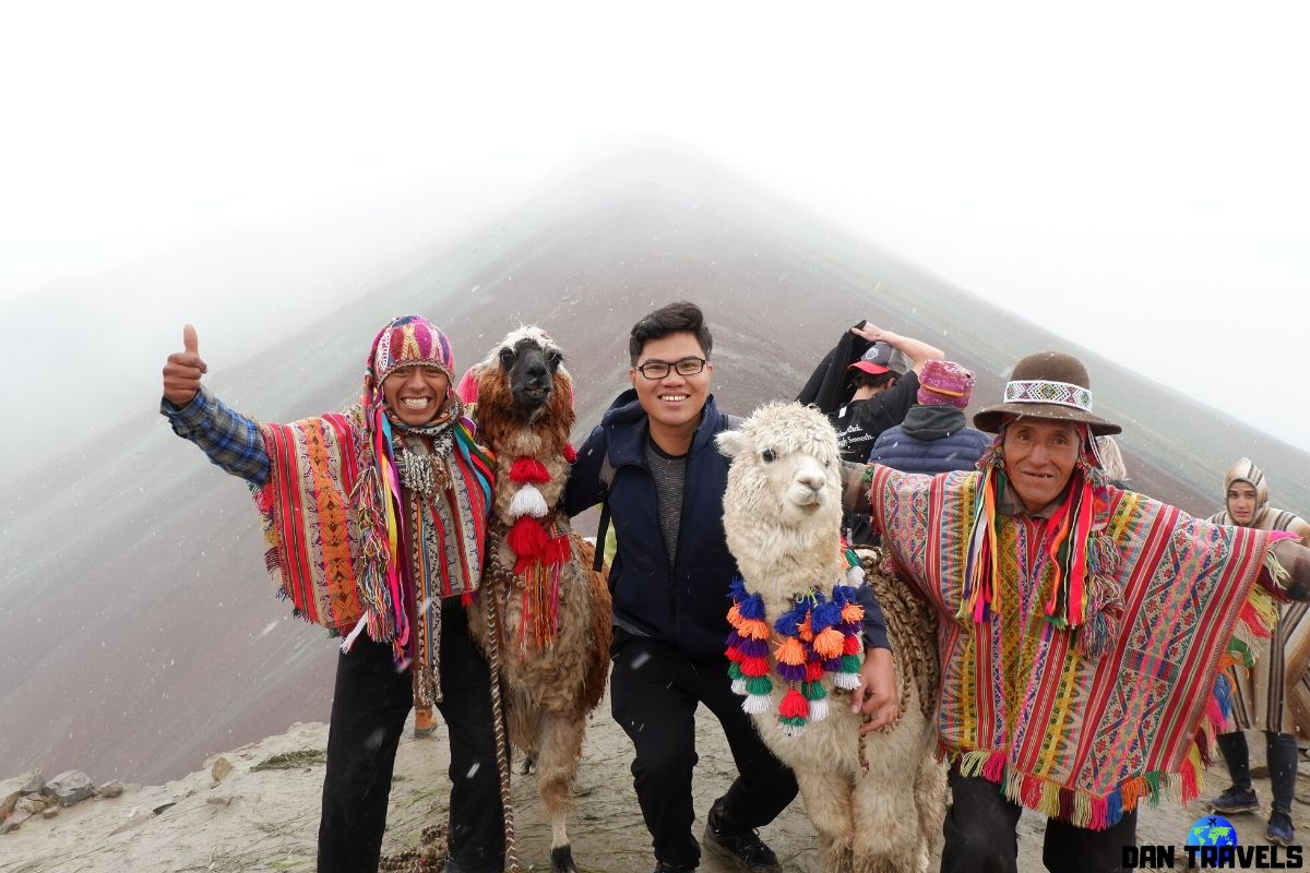 Day 7: Photo Op with locals at the Rainbow mountain. Snowy weather that day.